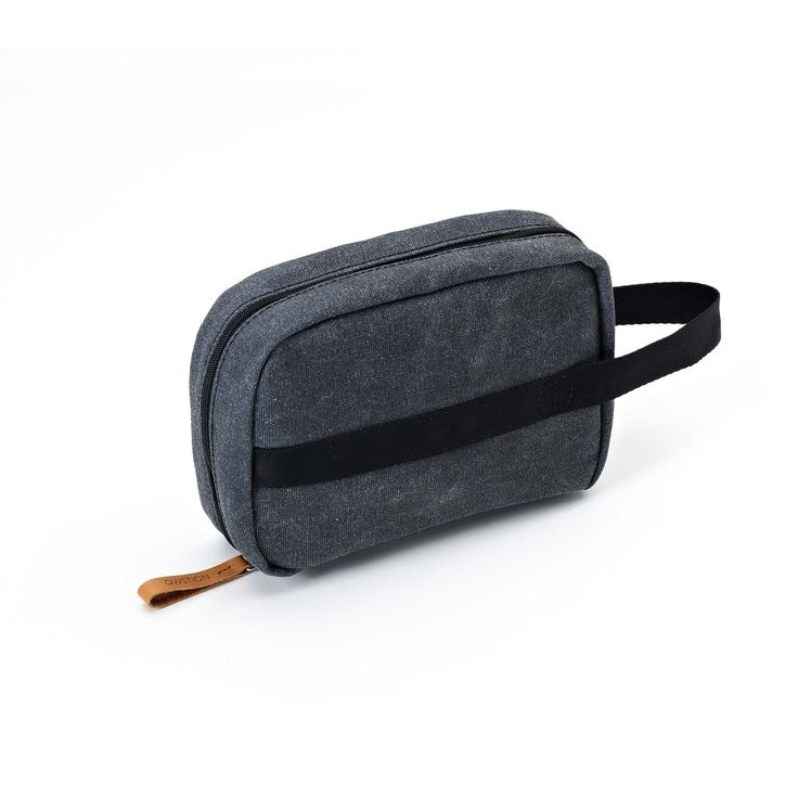 QWSTION - TOILETRY KIT - WASHED BLACK - The Toiletry Kit is the perfect add-on for the road, the air or wherever else your travels may take you. This compact, functional piece of luggage comes in our signature-coated canvas, multiple storage pockets will keep your toiletries organised during your travels and the easy access hanger will allow you to have everything readily available wherever you end up.