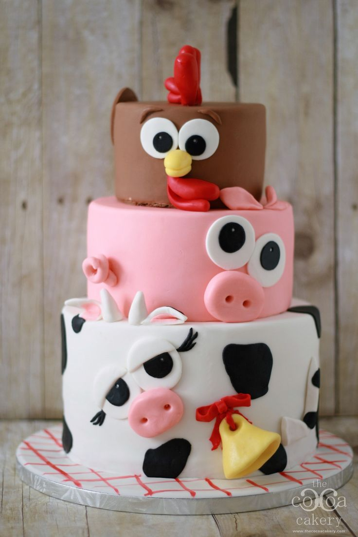 Chickens, Pigs and Cows - oh my! Check out this farm animal inspired birthday cake, this delicious cake is perfect for your child's Down on the Farm birthday party.