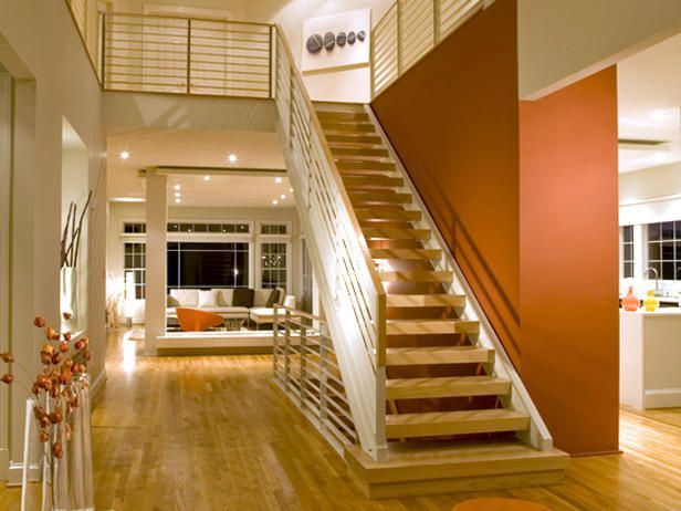 "Entry Wall Color Orange This home takes ""open concept"" to a whole other level. The orange color"
