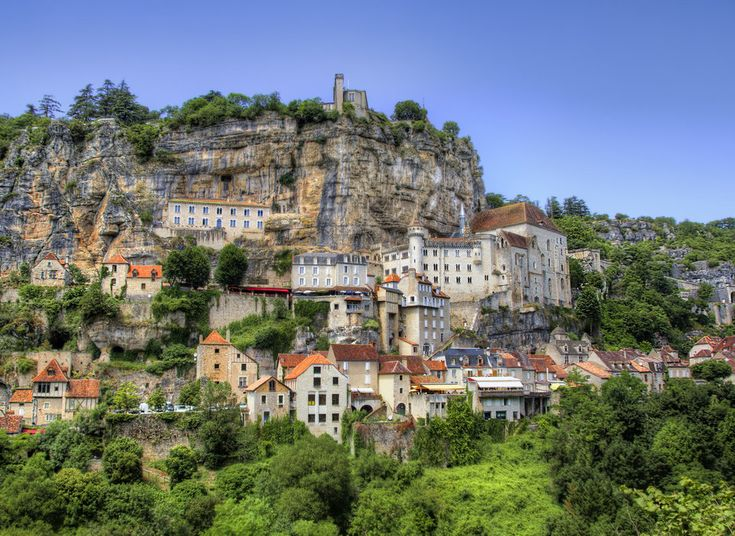 Rocamadour Rocamadour, France tree outdoor Town historic site landmark human settlement Village vacation tourism monastery cityscape ancient history Ruins unesco world heritage site panorama castle