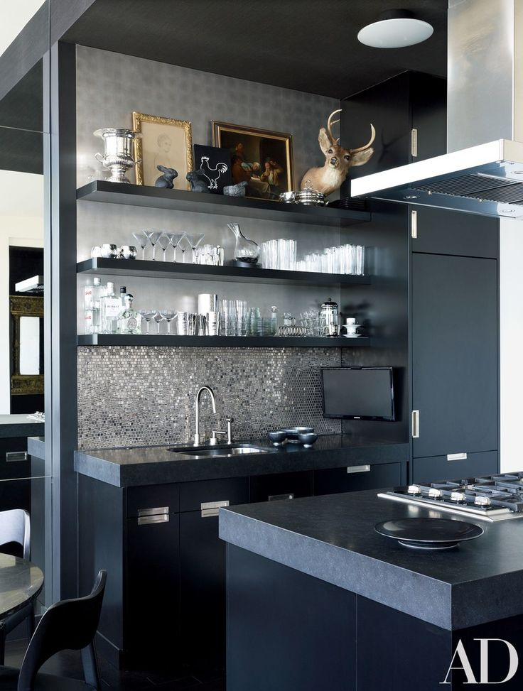 The kitchen includes a Sicis mosaic-tile backsplash, a Samsung ultrathin LED television, and a Sub-Zero refrigerator with bespoke lacquer panels.