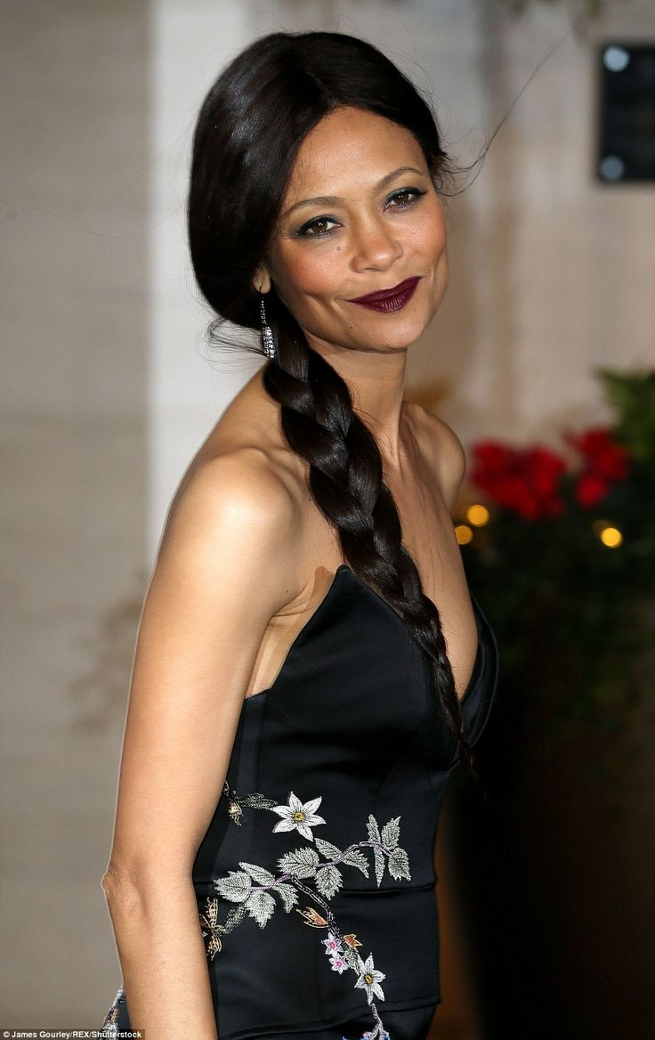 All tied up: After the show, Thandie pulled her hair into a side plait ...
