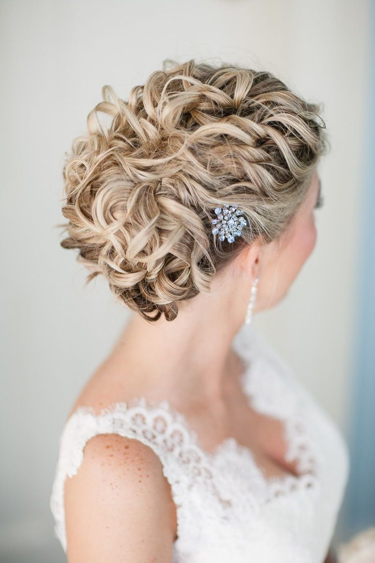 wedding hairstyles: low bun updo with textured curls and