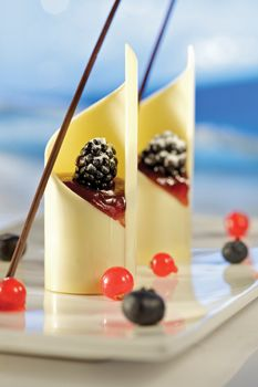 Mini Extreme White - No recipe. Basically, a white chocolate cover filled with any mousse & topped with berries.