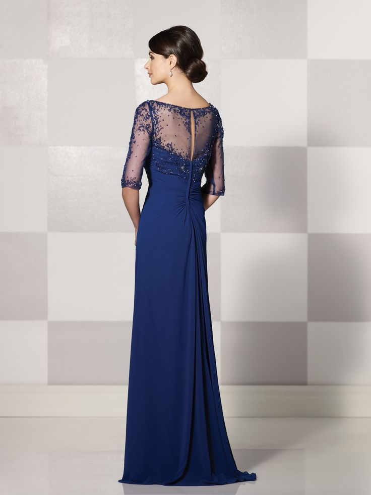 214689 -     Georgette chiffon mock-wrap A-line dress with hand-beaded illusion elbow-length sleeves, beaded illusion modified V-neckline over a sweetheart bodice, sheer beaded keyhole back, empire waist features cascading side ruffle accented with beaded motif, sweep train, suitable for wedding guest and formal events.  Embellish by David Tutera earring style Claire sold separately.