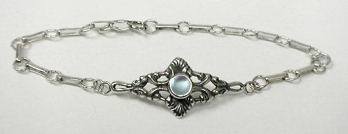Sterling Silver Victorian Chain Bracelet Accented with Genuine Blue Topaz The Silver Dragon- Bracelets. $49.00. This Unique Bracelet is Created only after Your Order Arrives. Please Allow 7-10 days for Delivery.. This Bracelet was Designed by The Silver Dragon, a Jewelry Shop in New England. Thank you for Supporting American Business.. The Silver Dragon uses Sterling Silver that has been Reclaimed... Helping Save Mother Earth's Resources.. Designed And Hand- Crafted in Sterling S...