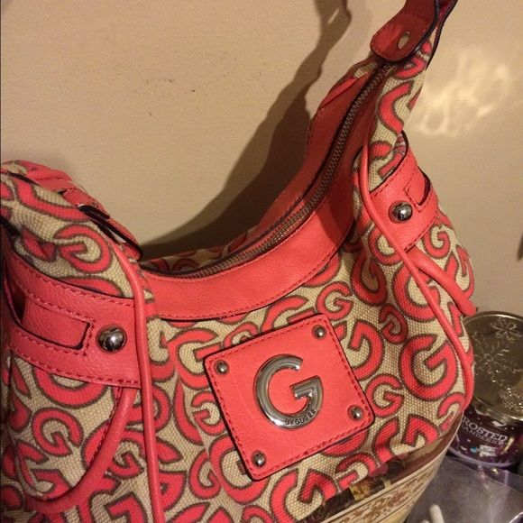 "Coral G by Guess handbag! Coral G by guess handbag with a ""G"" pattern. 2 side pockets plus a bunch of interior pockets. In really great condition!! G by Guess Bags Shoulder Bags"