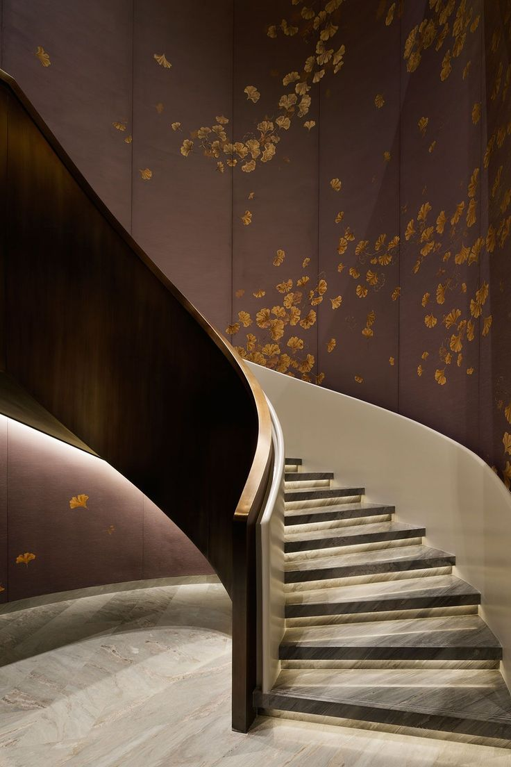 YABU PUSHELBERG Waldorf Astoria Beijing with wood instead of marble and a different artwork on the walls (maybe birds in some trees???)