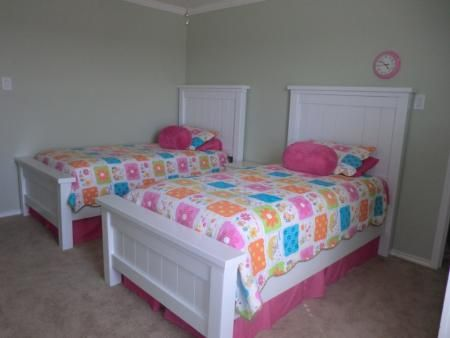 Twin Farmhouse beds by Ana White, but with info on how to modify with mounted bed rail brackets to make it easier to take apart.