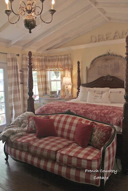 Delicate, carved details on the wood furniture and a mix of patterned fabrics including basic plaid make for an inspiring French Country Bedroom.
