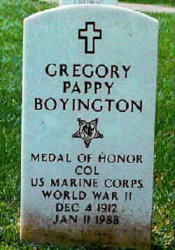 """Grave site at Arlington of Gregory """"Pappy"""" Boyington, a United States Marine Corps officer who was an American fighter ace during World War II. For his heroic actions, he was awarded both the Medal of Honor and the Navy Cross. Boyington flew initially with the American Volunteer Group in the Republic of China Air Force during the Second Sino-Japanese War. He later commanded the U.S. Marine Corps squadron, VMF-214 (""""The Black Sheep Squadron"""") during World War II."""