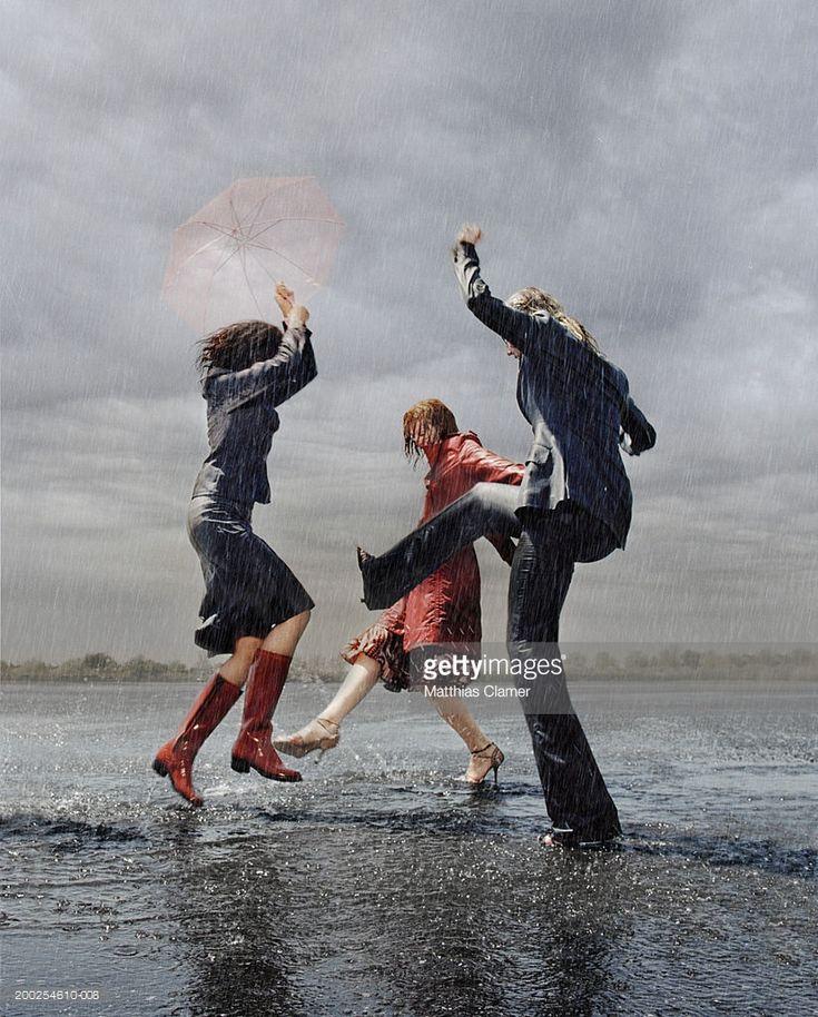 Three women having fun in the rain