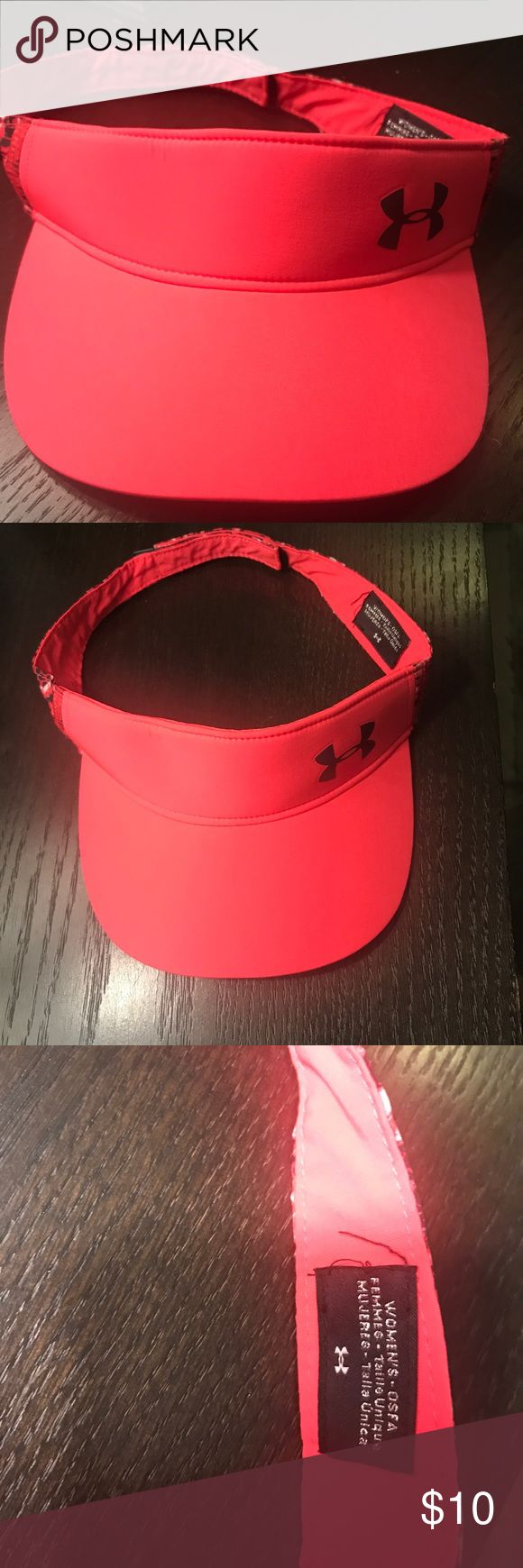 Under Amour woman's visor Worn one time like new woman's visor in bright pink. Smoke-free home.  Bundle three items and save 15%! Under Armour Accessories Hats