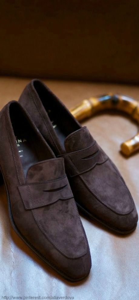 Brown suede penny loafers.