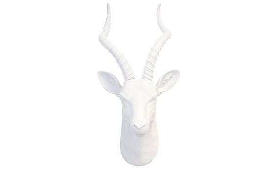 Faux Taxidermy White Antelope Head - Large All White Resin Gazelle Faux Taxidermy Home Decor  The African gazelle / antelope is a beautiful and graceful animal known for its long slightly curved horns. Add an elegant touch to your home with this sleek all white piece and bring your living space to life with this gorgeous animal displayed as a focal point! The all white color scheme will work well in a more modern setting.  Show off your love for animals by displaying this beautifully cra...