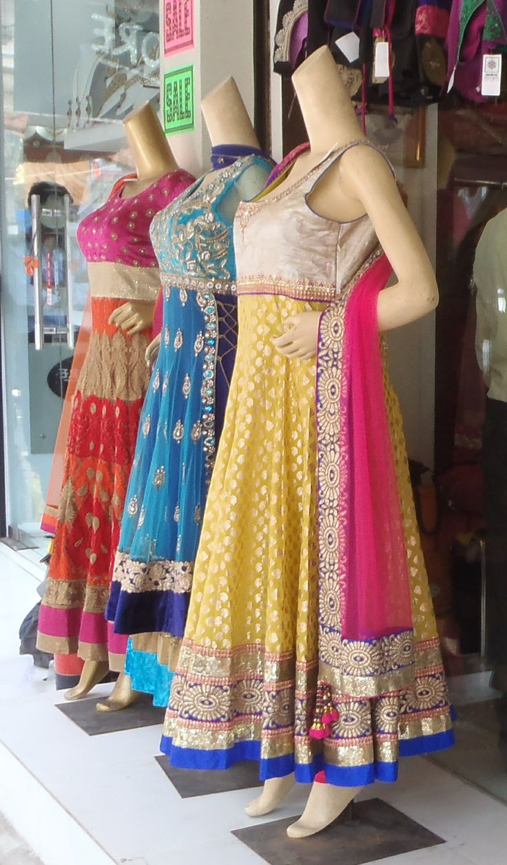 Since everyone wants to know *what* exactly is available at Karol Bagh - here is a set of blingy but not super-expensive formal salwar suits for women. The sleeveless ones almost all come with optional attachable sleeves. Shops will often provide alteration services. Many use mass-produced machine-embroidery (will be less expensive). More ornate hand-embroidered ones are obviously more expensive, and will usually have less tacky tailoring as well.