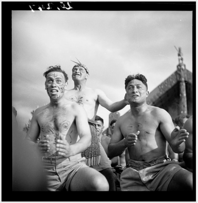 Members of the Maori Battalion performing a haka at the opening of the Tamatekapua meeting house at Ohinemutu in 1943. Photograph taken by John Pascoe.
