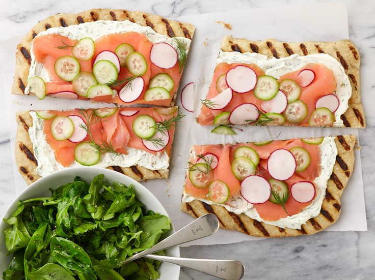 Try a schmear of lemony cream cheese and sliced smoked salmon on something other than a bagel: grilled pizza crust adds a wonderful flavor.