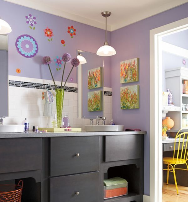 Purple kids' bathroom with ample color and attractive wall art