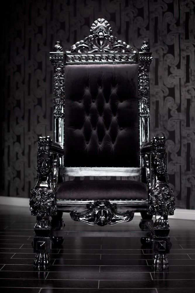 BLACK LACQUER BAROQUE THRONE CHAIR - Be the king or queen or your house in this magnificent throne chair. Reminiscent of the thrones royalty used to sit in during the Baroque period and hand-carved out of the highest quality imported wood, this large chair exudes grandeur and sophistication. Upholstered in the finest black velvet and finished with beautiful chrome studs, this chair is the perfect rock star addition to any home.  As with many of our items, it can be customized to make it ...