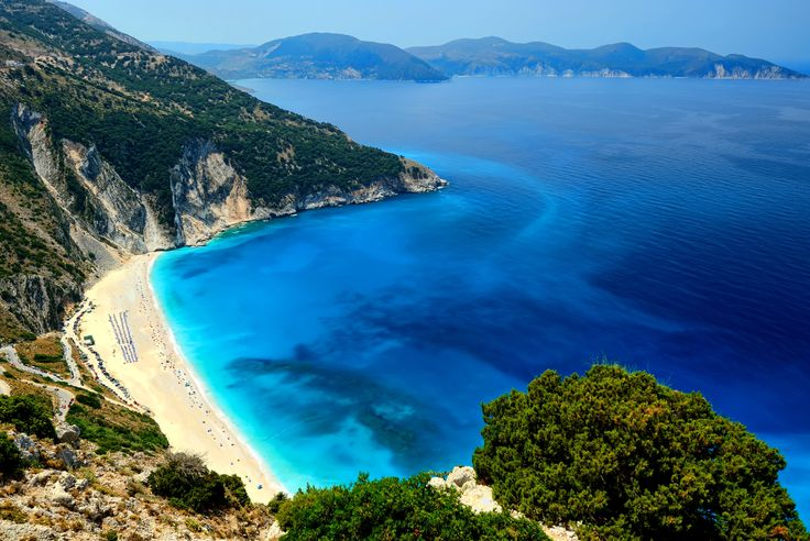 Myrtos Beach, Kefalonia: This amazing beach between Assos and Argostoli is literally breathtaking. Unquestionably the most famous on the island, it must be included in any top beach list for Greece. White sand, fine pebbles, azure waters at the foot of impossibly high cliffs – once seen, it's unforgettable.