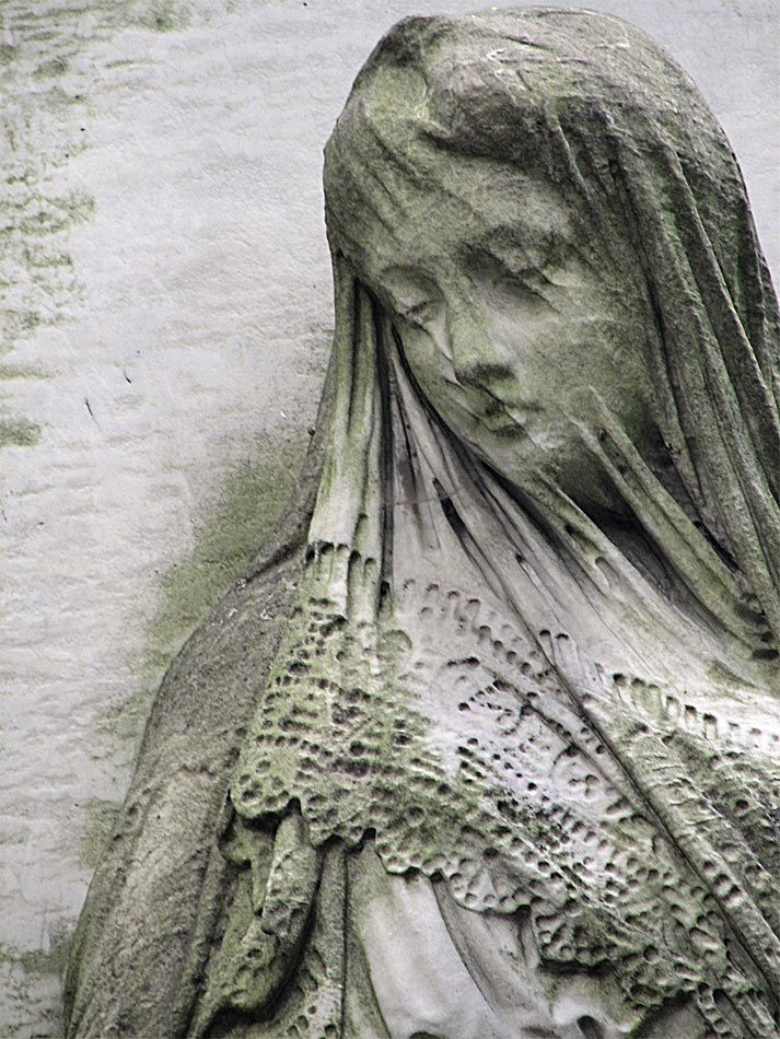 Stone Sculpture. I absolutely love how they can get it to look like she has a veil over her face, and so realistic.