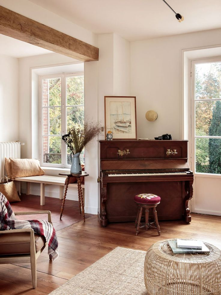 Piano in the sitting room of Normandy country home