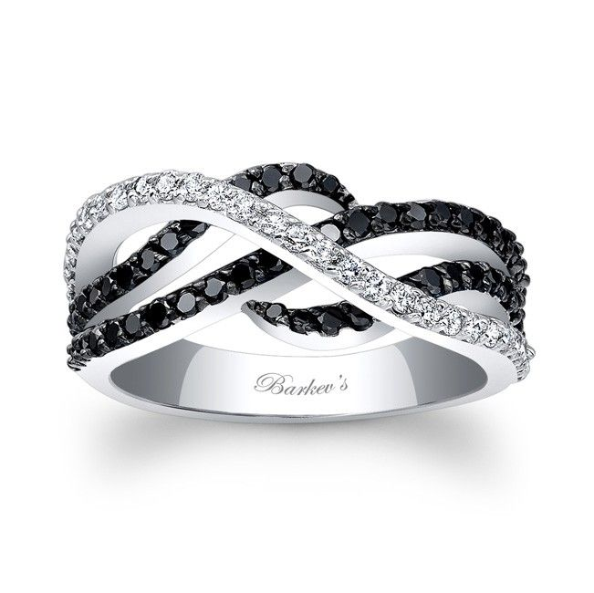 Black and white and stunning, this white gold, shared prong set, black and white diamond band exudes a sense of style and sophistication.