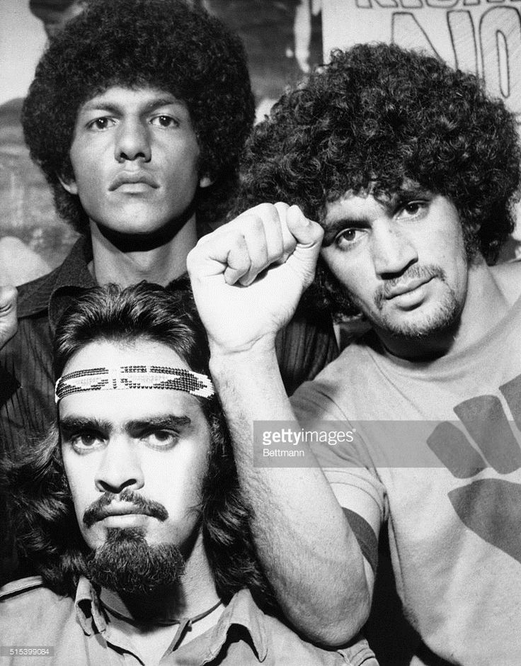 Black power has hit white Australia. Gary Foley, 21-year-old 'field marshal' of the Australian Black Panther Party, says his group is training aboriginals in 'urban guerrilla tactics and the use of explosives.' Members of the aboriginal black power group, one showing clenched fist, are shown in recent photo.
