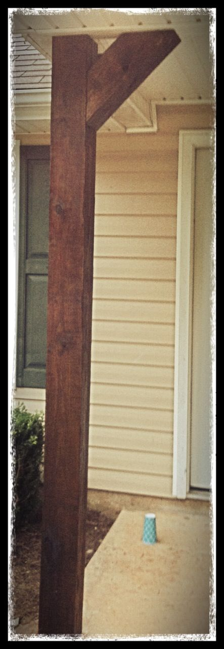 Putting up new front porch posts.  I love a thick chunk of wood!  6x6 wood beams stained and cut.  ;)
