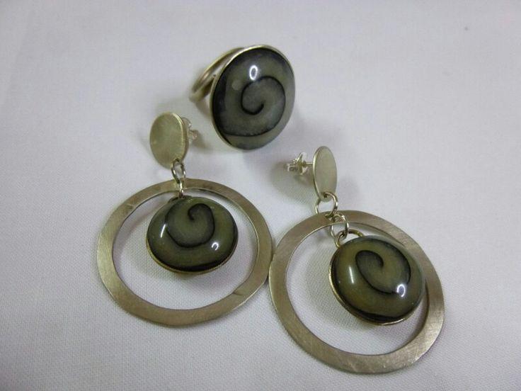 Anello e orecchini in metallo e pasta polimerica