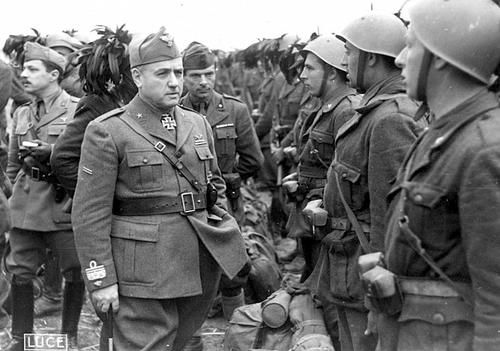 The commander of the Italian Expeditionary Corps in Russia (Corpo di Spedizione Italiani in Russia - CSIR) General Giovanni Messe (1883-1968) reviews the formation of Italian soldiers.