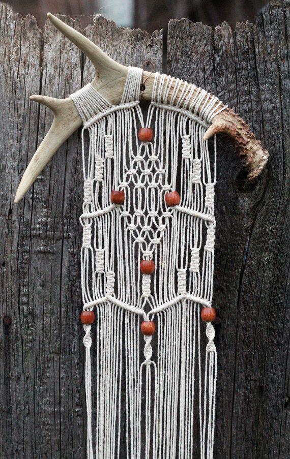 Macramé wall hanging on deer antlers with vintage wood beads