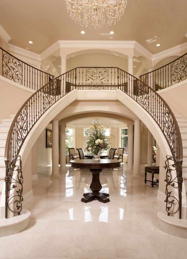Entrance Foyer Circulation And Balcony In A House : Luxury iron banister dual staircase grand entryway