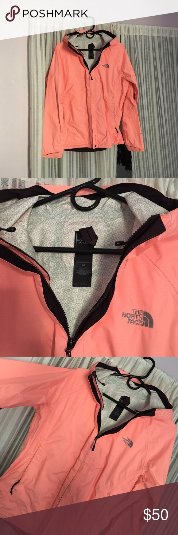 North face windbreaker sz S women neon peach Bright color, cute orangey/pinky windbreaker from north face. Has a dark purple plum trim and white pattern inside . Keeps you dry but not too hott. Willing to trade for similar style. North Face Jackets & Coats