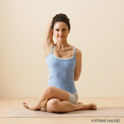Cow Face Pose - Gomukhasana - (go-moo-KAHS-anna) - Benefits:  Stretches the ankles, hips and thighs, shoulders, armpits and triceps, and chest