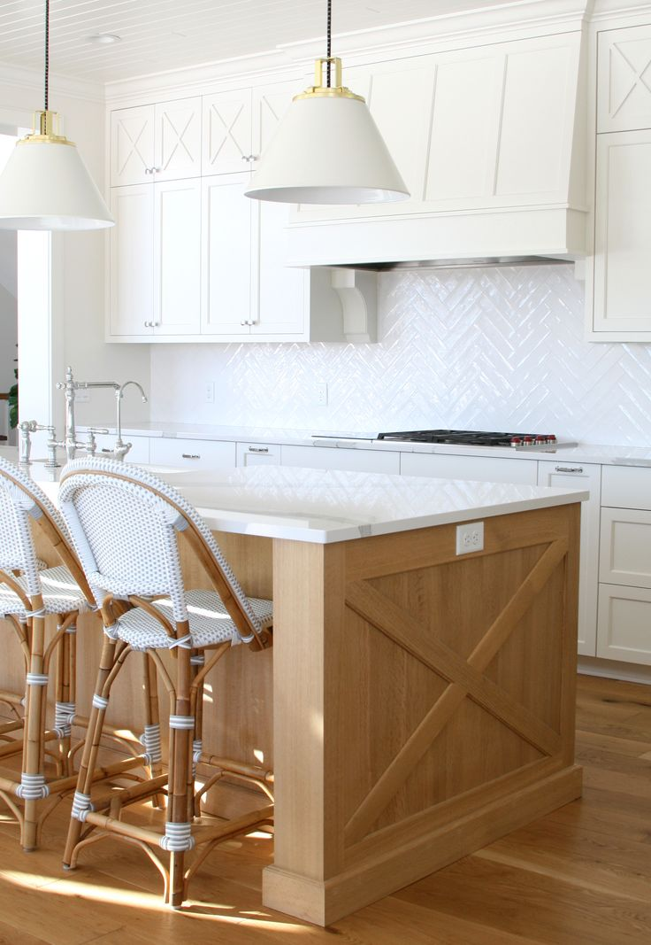 White full-overlay cabinets combine with quartersawn white ...