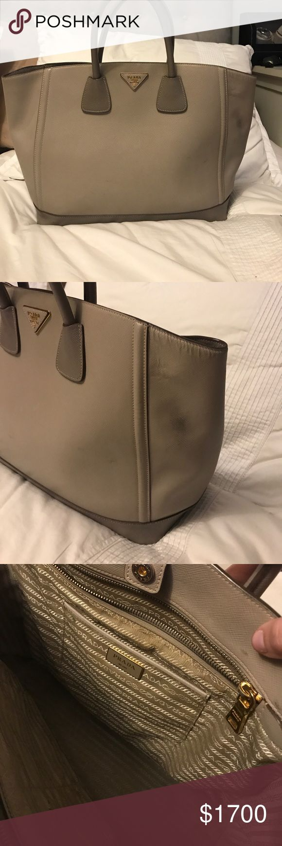 Prada bag Grey Prada bag for sale. Small black marks on the side but all in all in good condition! Prada Bags Satchels