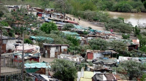 Itipini, a shantytown community built on a garbage dump outside a small town in South Africa.