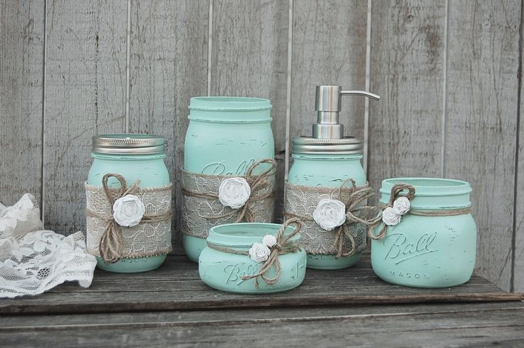 Rustic mason jar distressed, wrapped with burlap, lace, tied with jute and white roses and finished with a protective coating. Metal soap