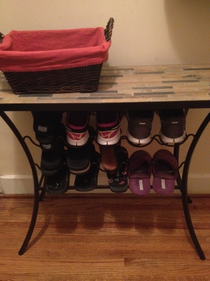 Repurpose Wine rack into Shoe Storage/organizer.  Babies like to eat shoes, not drink wine.  So we use our wine rack to place shoes by the door! It also makes a handy table right when you come in the door.