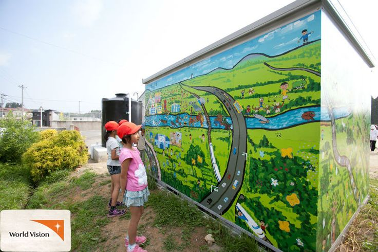 Children in #Japan look at their #artwork on a storage container, which shows off children's #dreams for the future. The container is full of #emergency supplies like #blankets, generators and portable #toilets, so their community is prepared for #emergencies.