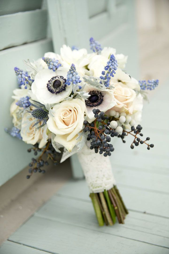 Beautiful combination of unusual flowers. Anemones, roses, berries, and grape hyacinths