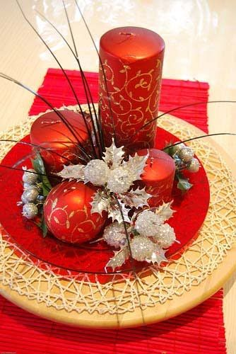 Candle centerpiece in gold and red.