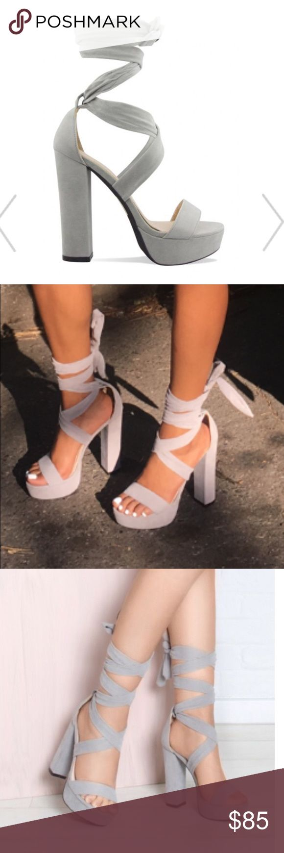 Grey tie up open toe heels Worn only ONCE!!!! grey high thick heel open toe tie up heels! only reason I'm selling these is because they are to big. Make a offer please! Shoes Heels