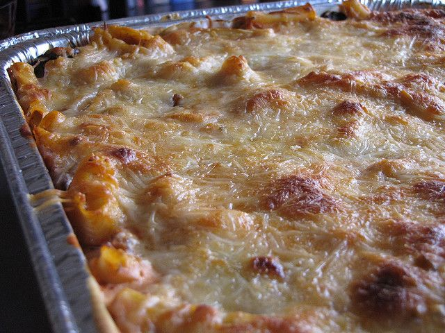 Baked Ziti for a crowd   (makes 4- 9x13 pans)   and freezes well