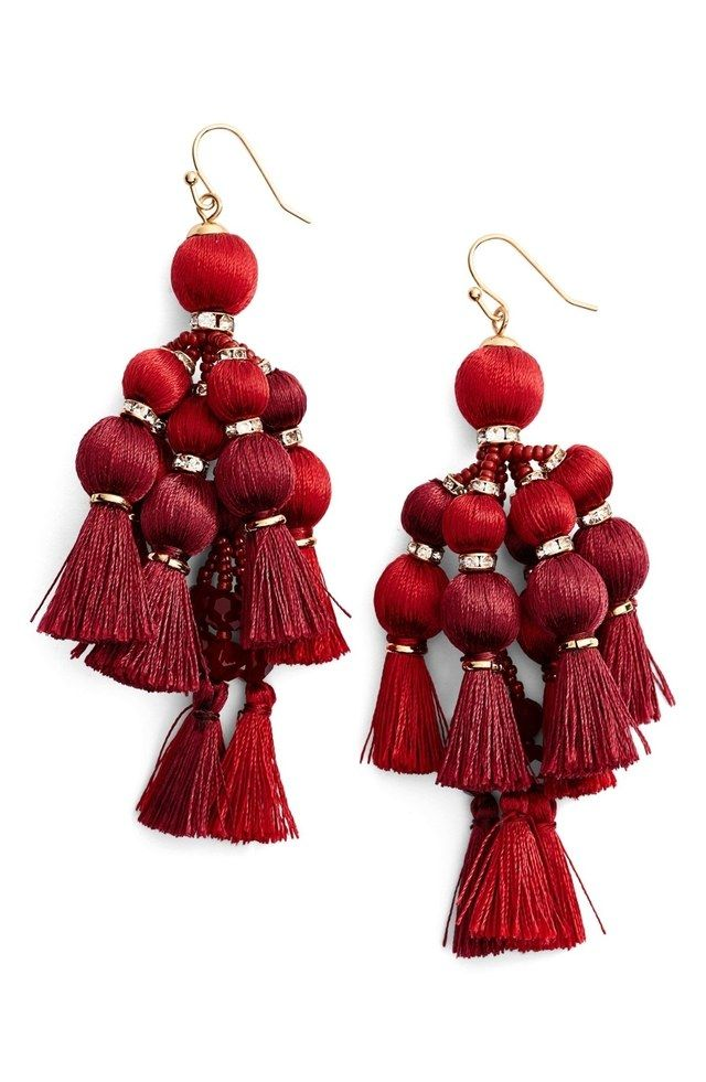 Add a vibrant statement to your outfits with these red drop earrings from Kate Spade. Featuring playful tassels and sparkling charms.