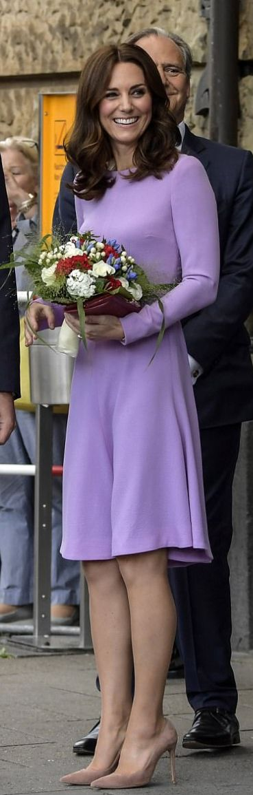 Who made Kate Middleton's purple long sleeve dress, red clutch handbag, and tan suede pumps?