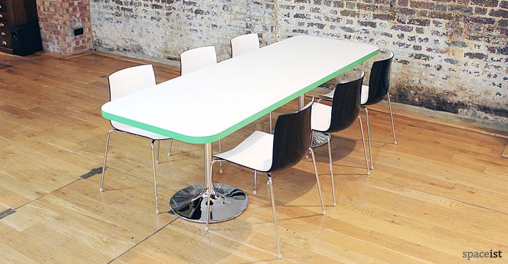 Edge green rectangular cafeteria table and chairs.