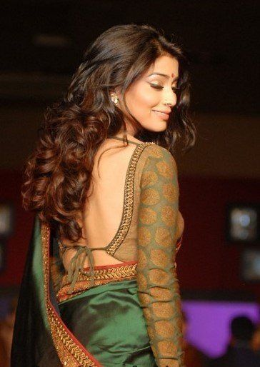Long-sleeved saree blouse and low tie back.